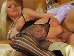 Incredible sexy blonde in stockings catsuit takes two