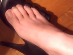 Nana takes her shoes and nylon socks off