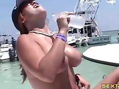 Alluring babes go topless in an out of control boat party