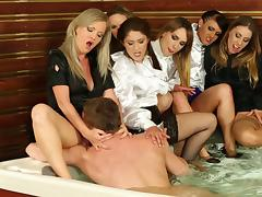 Clothed orgy in the hot tub with sluts sharing a big dick