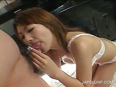 Japanese in lingerie licks a horny dick