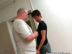 Bald guy rubbing pussy with dildo