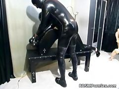 Kinky bitch is in latex suit and loves