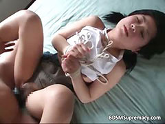 Cute asian babe is played with and gets