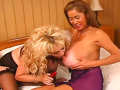 Minka and lusty friend with huge tits