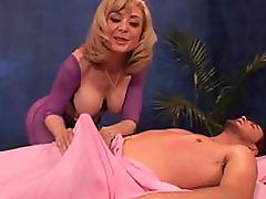Busty Blonde Mature Nina Hartley Gives Guy a Massage and a Blowjob