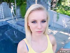 Pretty blonde Elaina Raye gives a nice handjob outdoors