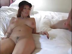Redhead blows him, puts a condom and rides his dick