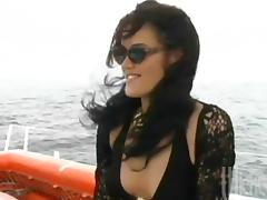 Three horny lesbians finger their wet pussies on a yacht