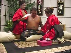 Horny geishas Annie Cruz and Kylie Rey share a cock